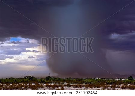 A Very Dense Shaft Of Rain Falling From A Monsoon Storm Near The White Tank Mountains In Southwester