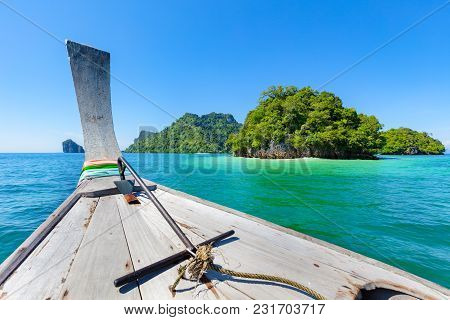 Closeup Of Longtail Boat In Sea During Summer At Aonang Beach Against Blue Sky