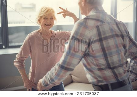 Content Pensioners Feeling Themselves Young, They Are Dancing At Home. Focus On Woman