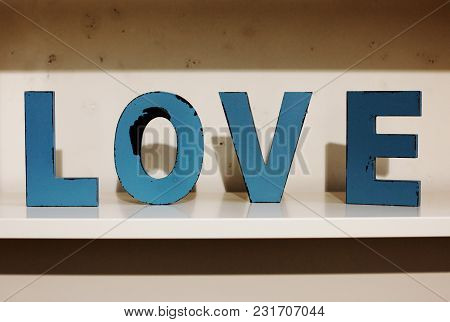 Closeup Of The Word Love Out Of Wooden Letters