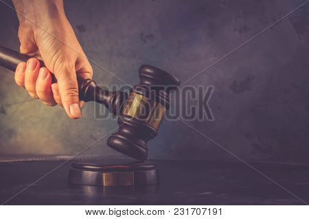 Someones Hand Holding Law Gavel - Law And Justice Concept, Retro Toned