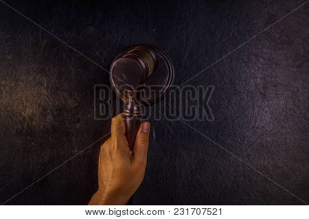 Hand Holding Law Gavel - Law And Justice Concept, Copy Space On Black Leather Background, Retro Tone
