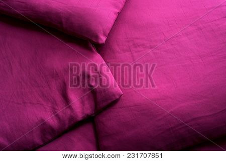 Magenta background. Abstract fabric texture of a saturated purple color