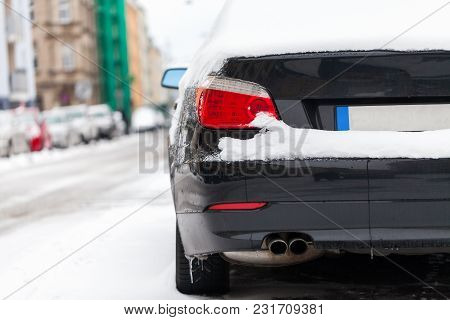 Snow Covered German Car Parked At The Roadside