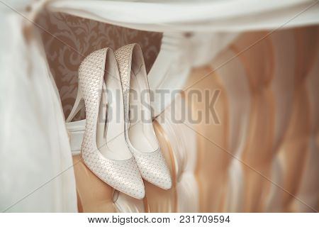 Delicate Wedding Shoes For The Bride. Fashionable Shiny High-heeled Shoes.