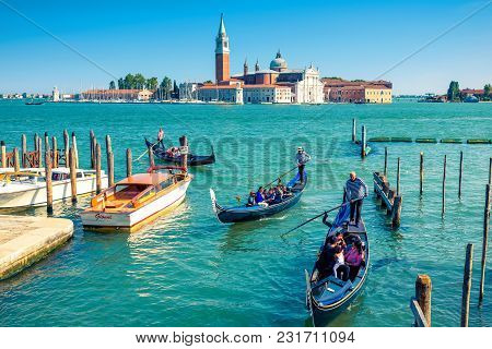 Venice - May 18, 2017: Gondolas Float Near San Marco Square In Venice, Italy. Gondola Is The Most At