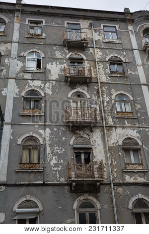 Typical Antique Portuguese Architecture: Grey Facade With Old Windows - Portugal.