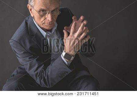 Old Businessman Expressing Anger While Gesticulating Hands. Wrathful Pensioner Concept. Copy Space