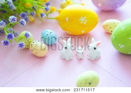 Easter Rabbit With Easter Eggs On Wooden Background. Close-up.