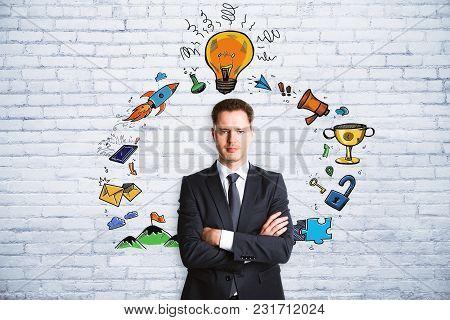 Presentation And Infographic Concept. Portrait Of Handsome European Businessman Standing On Brick Wa