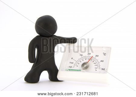 Black Plasticine Characters And Thermometer. Isolated On White Background