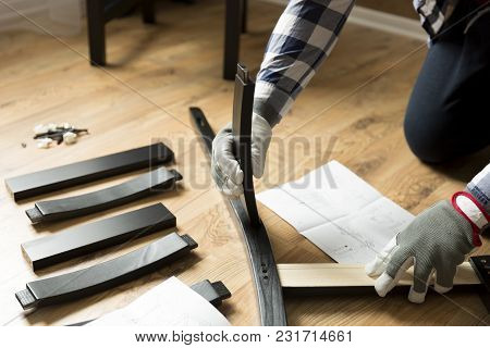 Assembly Of Wooden Furniture, A Woman Putting Together The Wooden Parts Of The Dining Chair, Using I
