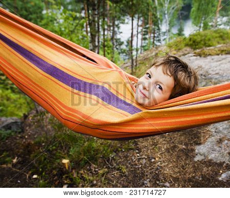 Little Cute Real Boy In Hammock Smiling Against Landscape With Forest And Lake Hight On Mountain, Li