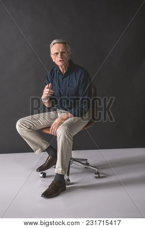 Hey You. Full Length Portrait Of Dissatisfied Old Businessman Pointing Finger While Locating On Chai
