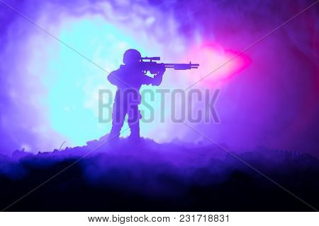 Army Sniper With Large-caliber Sniper Rifle Seeking Killing Enemy. Silhouette On Sky Background. Nat