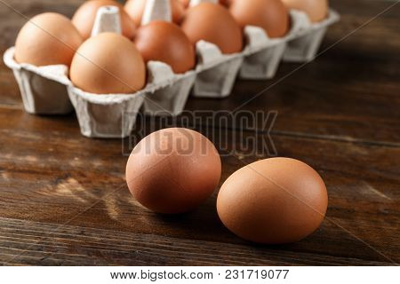 Two Chicken Eggs On A Background Tray With Eggs On A Wooden Background