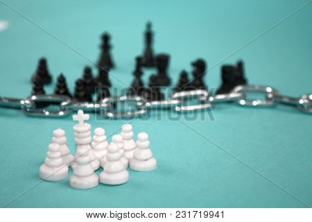 Defensive Group Of White Chess Pieces Pawns With King And The Others Behind The Chain Fence