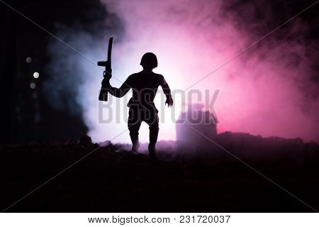 Military Soldier Silhouette With Gun. War Concept. Military Silhouettes Fighting Scene On War Fog Sk