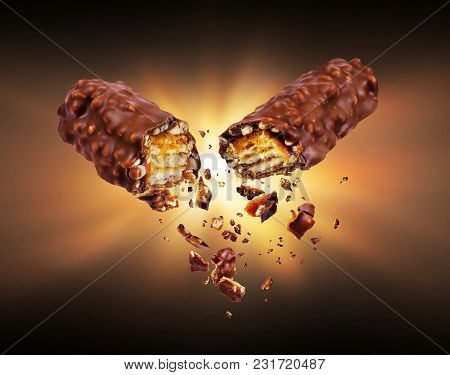 Waffle Chocolate Bar With Nuts Broken Into Two Parts In The Dark