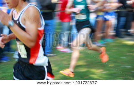 Motion blurred boys cross country team race