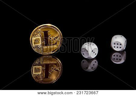 Risc Concept Picture. Gold Cripto Currency Litecoin Coin On Black Mirror Surface Next To Dices