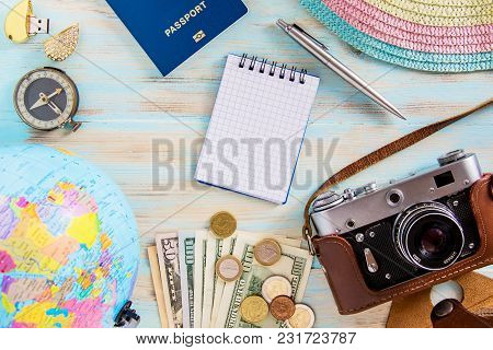 Travel Concept Image Of Accessories For Voyage Old Photocamera, Dollars, Hat, Passport And Compass