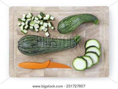 Zucchini Sliced And Chopped On Wooden Cutting Board With Knife Food Top View Isolated On White Backg