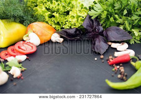 Frame Of Fresh Vegetables And Greens On A Dark Background. Healthy Diet With Vitamins