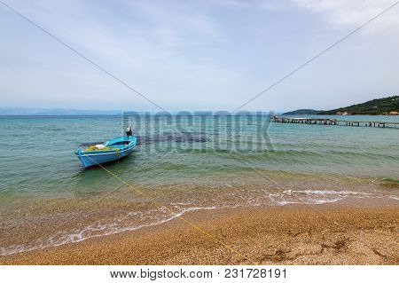 Boat Anchoring In Bay In Cloudy Day. Eastern Side Of Corfu Island.