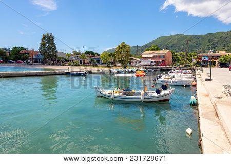 Corfu Greece - May 13, 2016:fishing Boat Anchoring In Port Of Ipsos On Corfu Island. Greece.