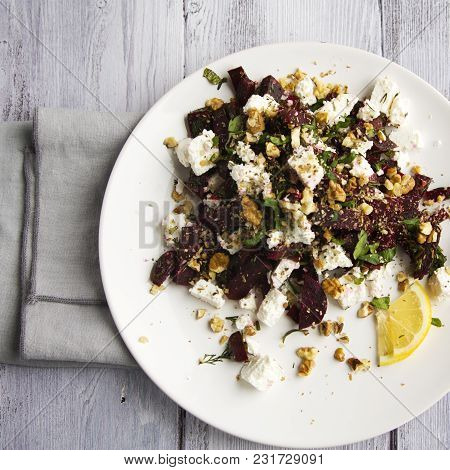 Beetroot Salad With Cottage Cheese And Walnuts. European Cuisine. Top View. Vegetarian Appetizer. Si