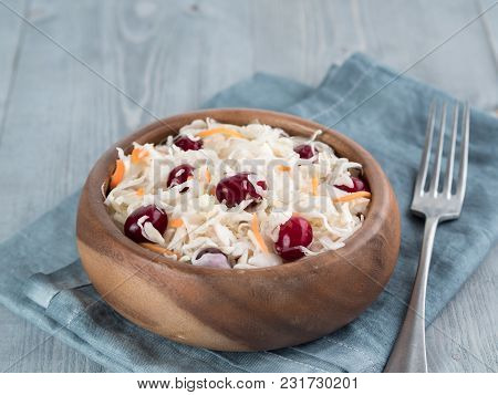 Traditional Russian Appetizer Sauerkraut With Cranberry And Carrot In Wooden Bowl On Gray Rustic Woo