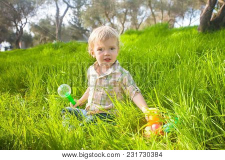 Cute Baby Boy With Easter Eggs