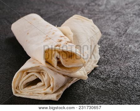 Armenian Flat Bread Lavash. Pita Bread On Black Cement Background. Copy Space.