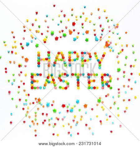 Creative Greeting Card Happy Easter. Text Happy Easter Made Of Multicolored Sweet Candy Dragees And