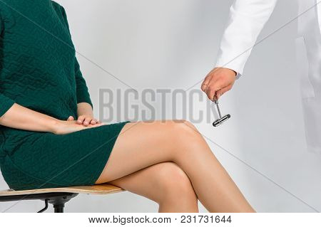 Orthopedic surgeon examining the knee reflex. The doctor checks the physiological reflex. Test hammer in the hand poster