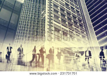 Silhouettes Of People Walking In The Street Near Skyscrapers And Modern Office Buildings In Paris Bu