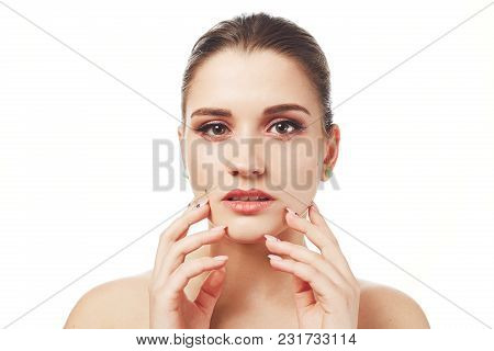 Indoor Shot Of Beautiful Adorable Female Model Demonstrates Soft Healthy Pure Skin After Spa Procedu