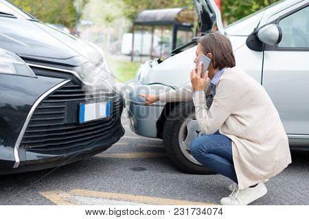 Woman Calling After Car Crash On The Street