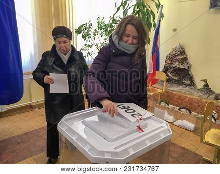 Moscow, Russia - March 18, 2018: The Voter Puts The Ballot In The Box In The Elections  Of President