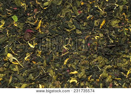 Background - Flavored Blend Of Green And Black Tea With Flower Petals Closeup