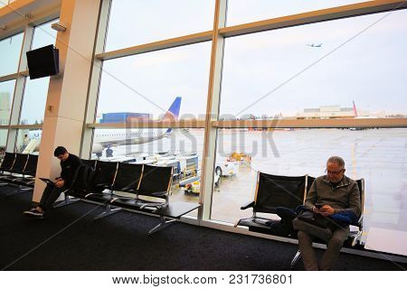 March 8, 2018 In Seattle, Wa:  People Seated On Rows Of Chairs Waiting For Their Flights Taken At Co