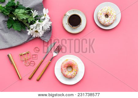 Modern Breakfast Desing With Sweet Donut, Cup Of Coffee And Flowers On Woman Pink Desk Background To