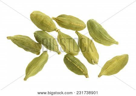 Green Cardamom Seeds Isolated On White Background. Top View. Lay Flat.