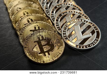 Two Rows Of Silver Litecoins And Golden Bitcoins Cryptocurerncy Coins. Conceptual Image Of Electroni