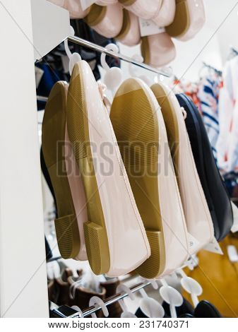 Shopping Time Concept. Garment Fashion Clothes In Botique Shop Market. New Collection Hanging In Sto