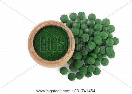 Spirulina Algae Powder And Pills In Wooden Bowl Isolated On White Background. Top View.
