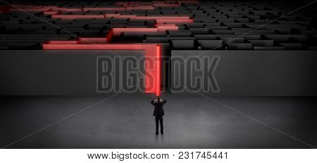 Businessman getting ready to enter the dark labyrinth with stated road concept