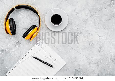 Composer Office Desk . Workplace Of Musician With Headphones And Notes Stone Background Top View Moc