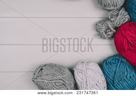 Knitting Accessories Assortment Background With Wool On Gray Wooden Table. Photograph Taken From Abo